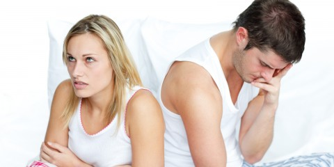 Woman getting fed up with her husband in bed